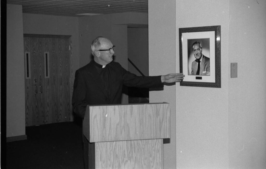 "John P. Raynor, S.J., speaks at the Humphrey Hall Dedication, 1990 (""Department of Special Collections and University Archives, Marquette University Libraries, MUA_010132)"