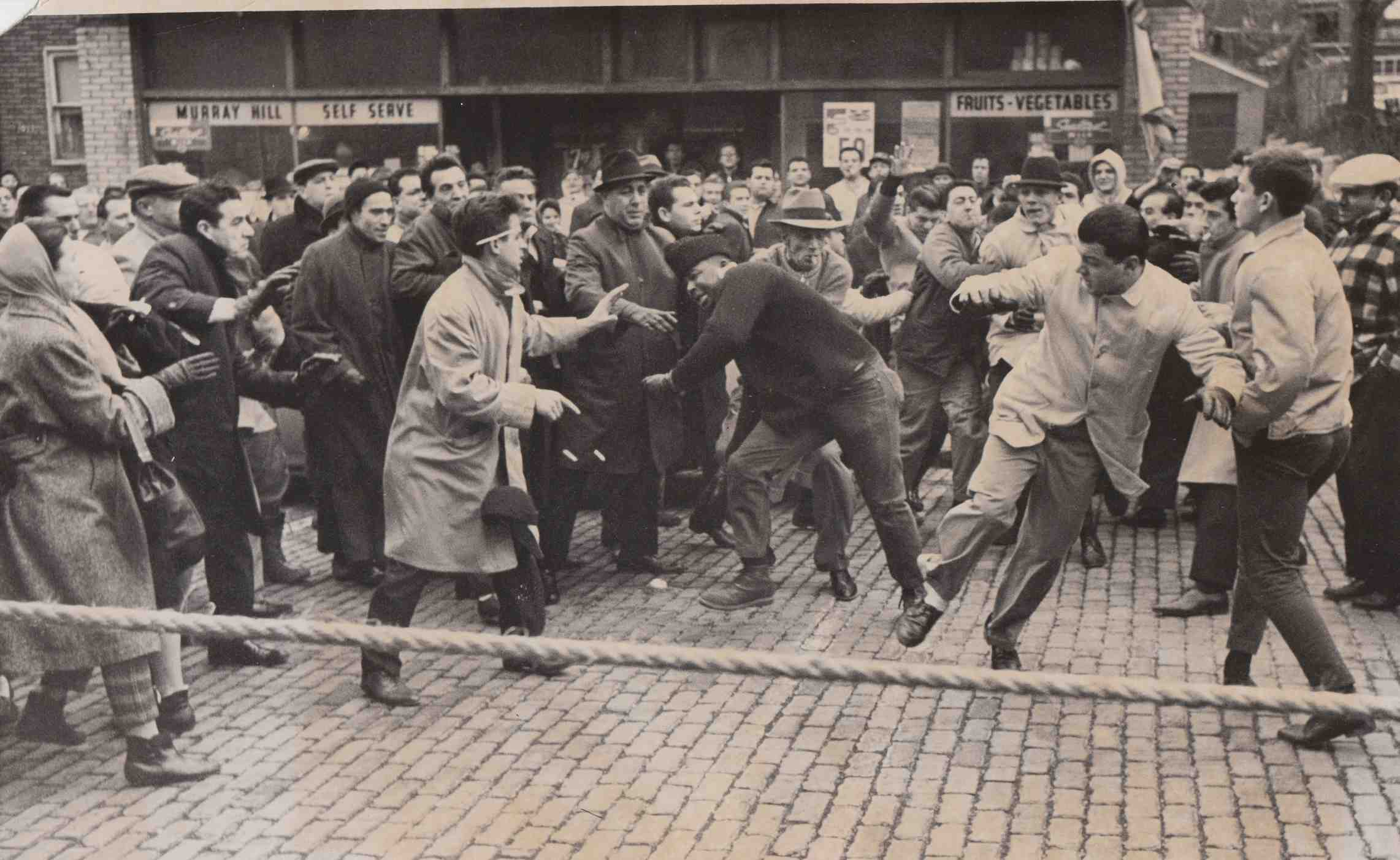 Whites attack a UFM demonstrator in the Murray Hill neighborhood in January 1964.