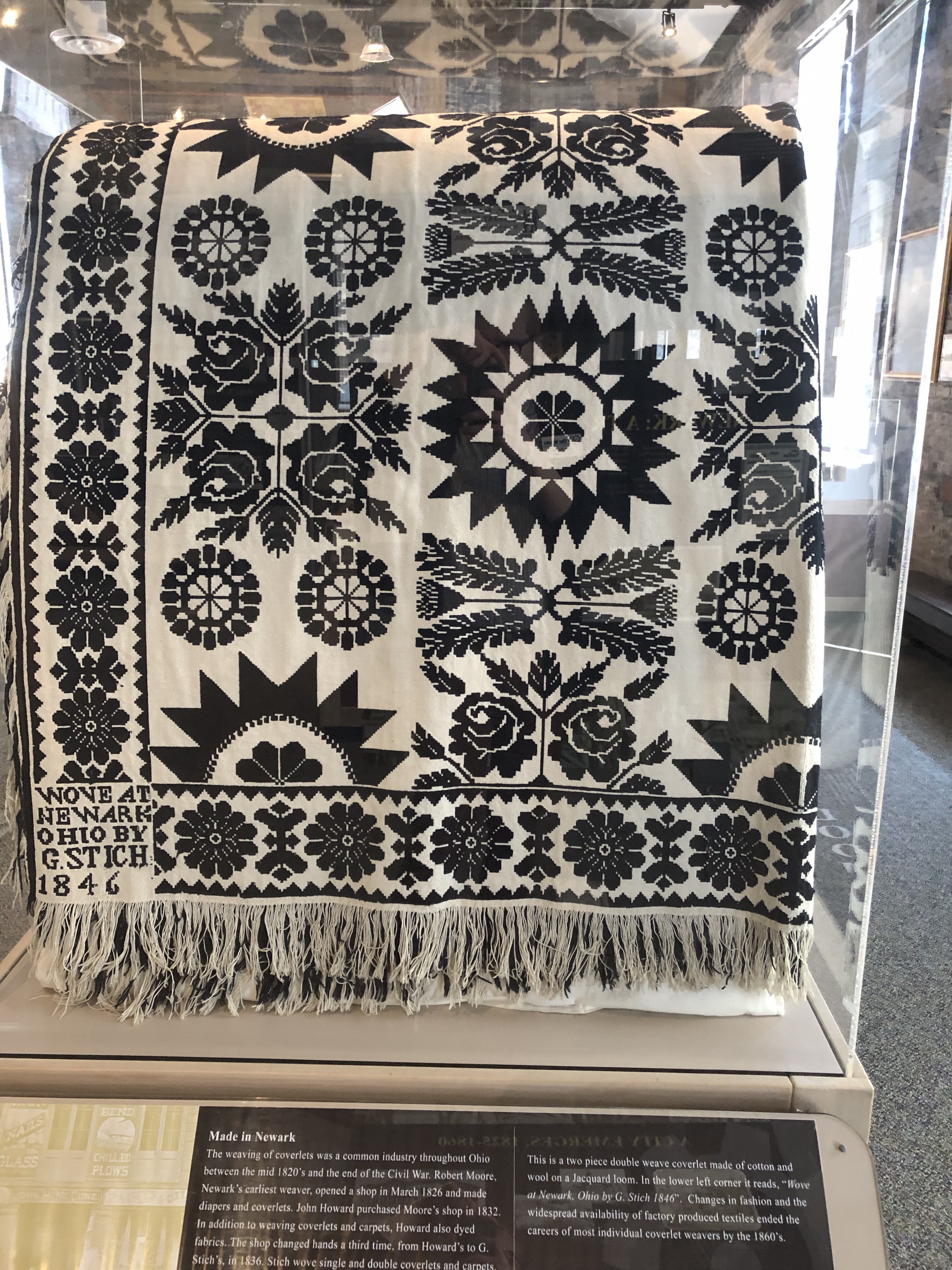 "This is a two-piece double weave coverlet made of cotton and wool on a Jacquard loom. In the lower left corner it reads, ""Wove at Newark, Ohio by G. Stich 1846."""