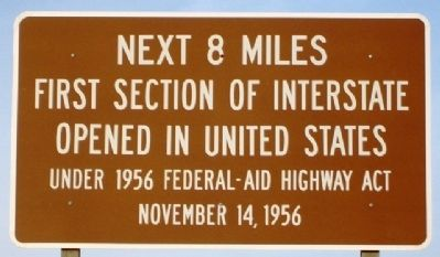 The marker indicating the location where the first section of the interstate highway was built.