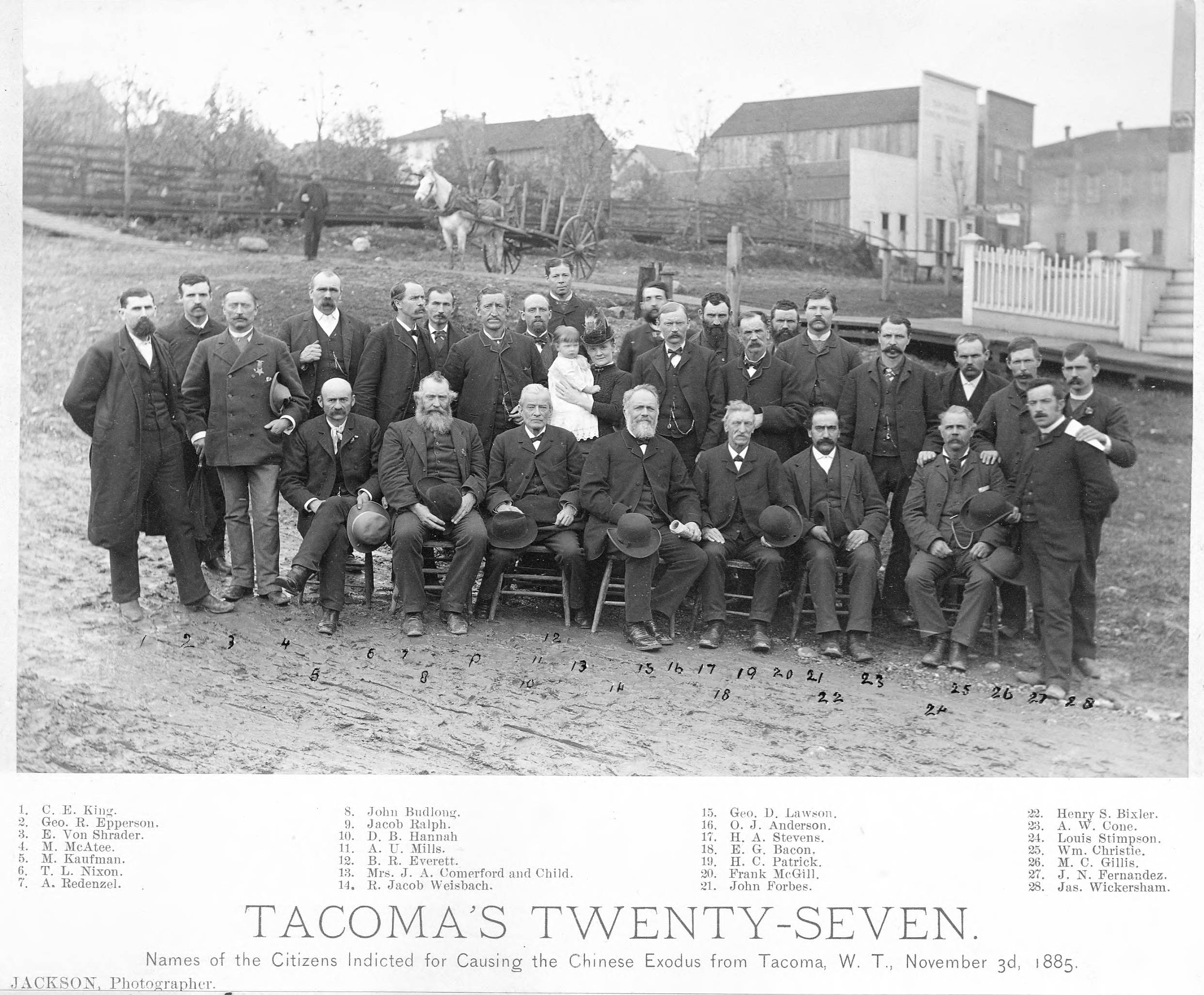 A group photograph of the original 27 Tacoma men indicted for the events of November 3rd, 1885.