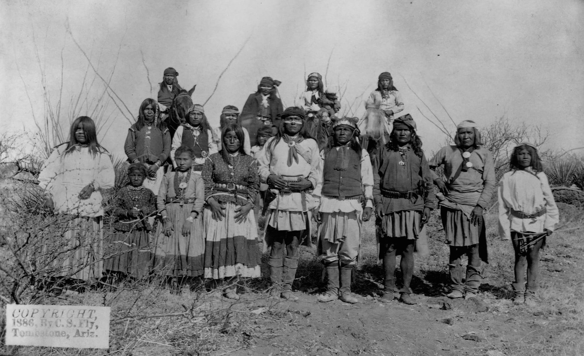 Geronimo stands with other Apache warriors, women, and children shortly before their surrender to Gen. Crook on March 27, 1886.
