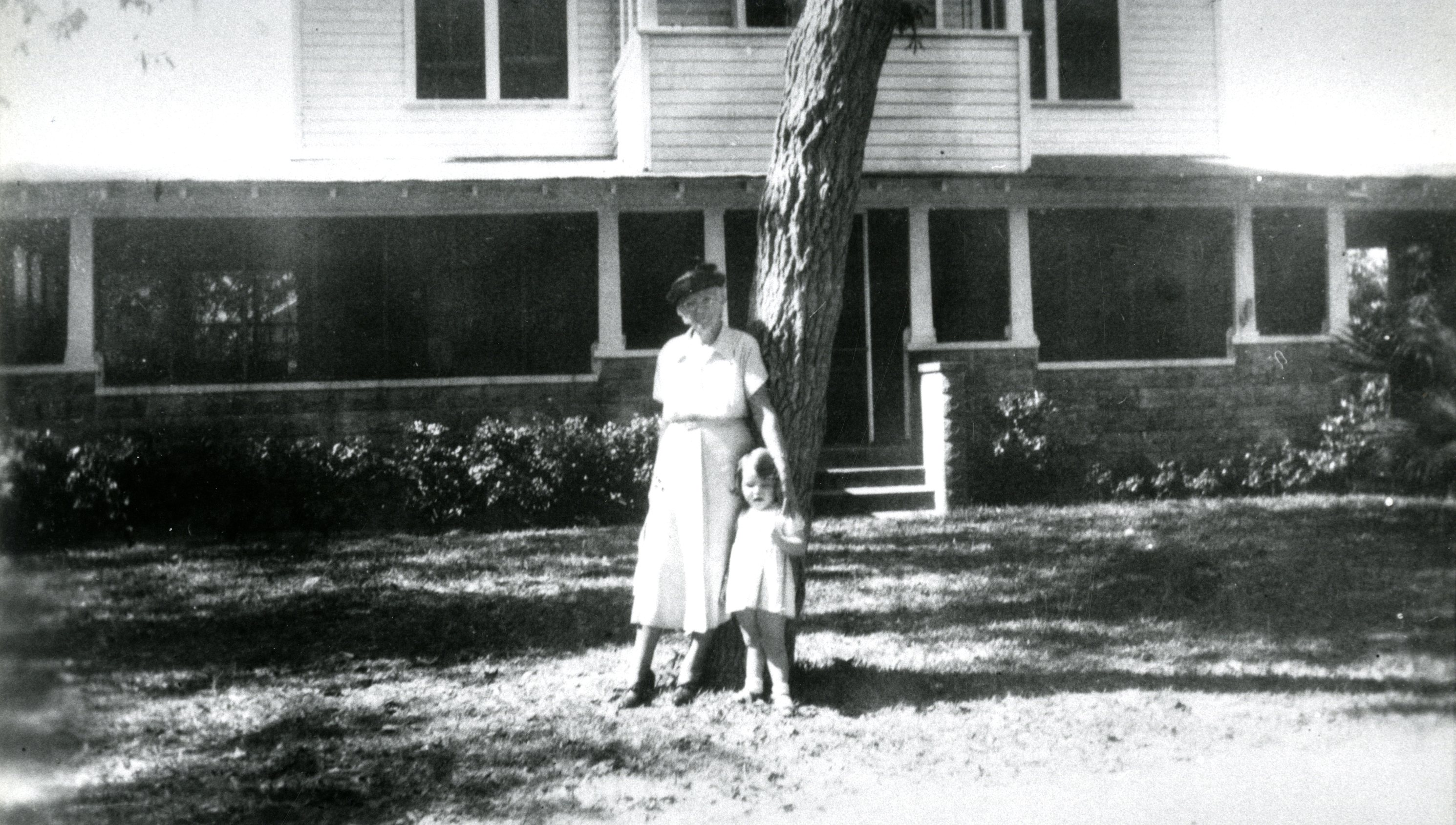 Mrs. Mayes and Kathy Knutsen in front of the Walsingham House, Largo, Florida, 1949.