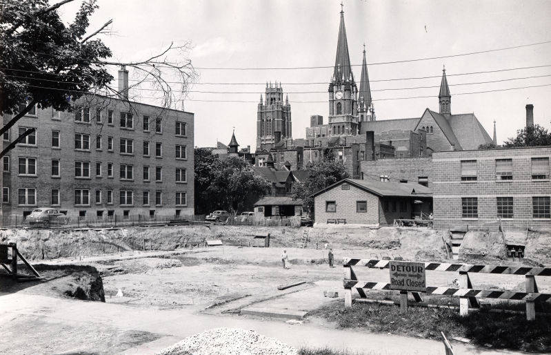 """View from 14th Street of the construction site of the Brooks Memorial Union (""""Department of Special Collections and University Archives, Marquette University Libraries, MUA_CB_00439)"""