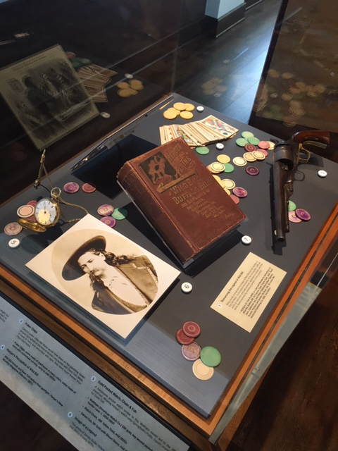 Case with items representing the shoot-out on the Springfield Square.