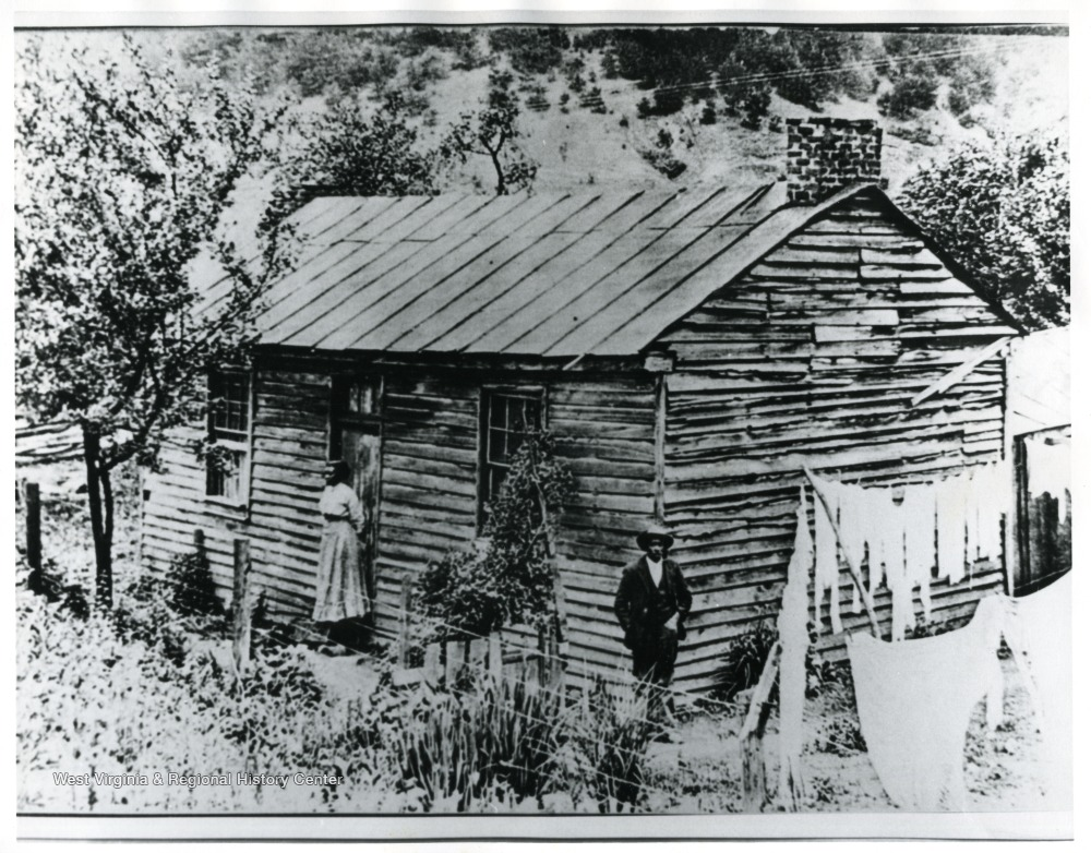 Home of Booker T. Washington - a replica of this cabin now stands behind the church
