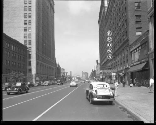 View down Broadway looking west between Third Street and Fourth Street, Louisville, Kentucky. The Brown Theatre can be seen on the right. ULPA R 50636, Royal Photo Company Collection, 1982.03, Photographic Archives, University of Louisville, Louisvil