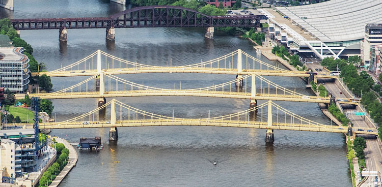 """The """"Three Sisters,"""" the Rachel Carson, Andy Warhol and Roberto Clemente Bridges, in order, from the top."""