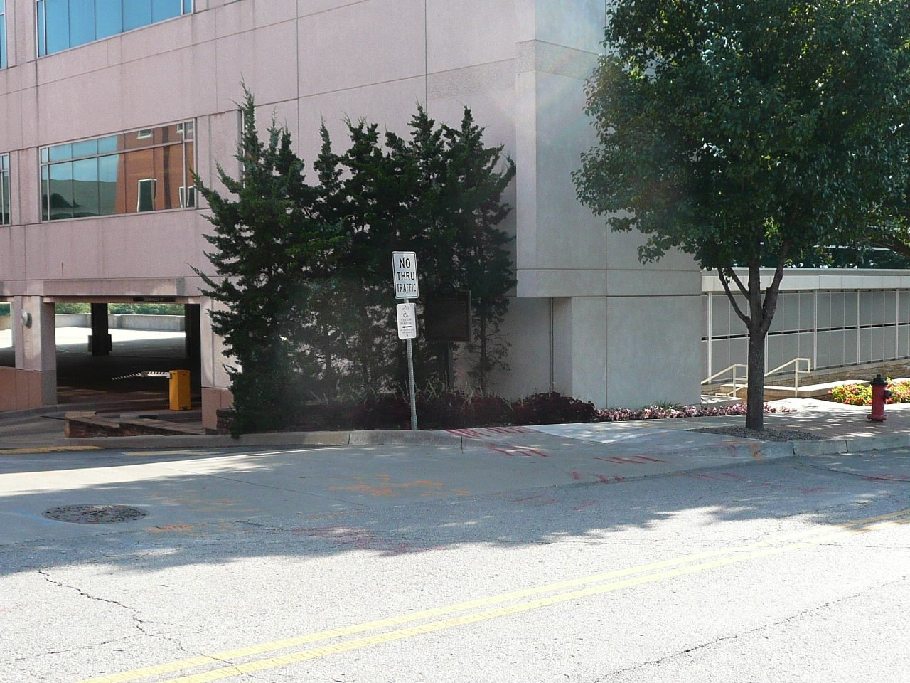 The marker is located beside a parking garage, near the original site of the cemetery. Image obtained from the Historical Marker Database.