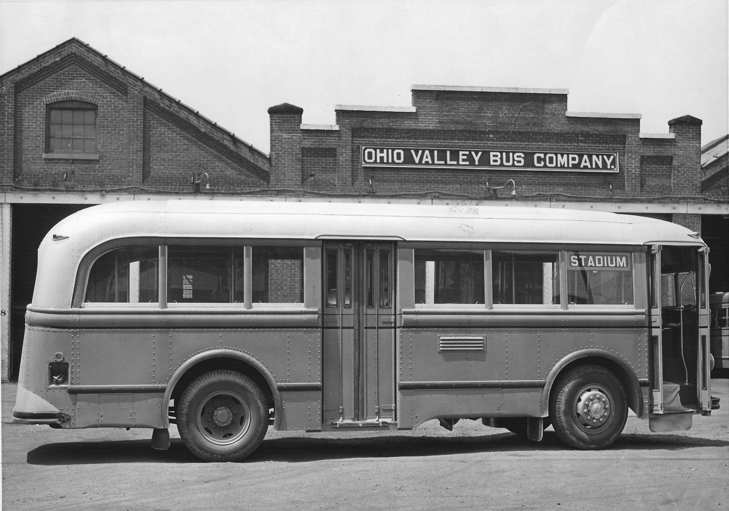 One of the Ohio Valley Bus Company's busses sitting in front of their bus barn located at the corner of 18th Street West and Adams Avenue.