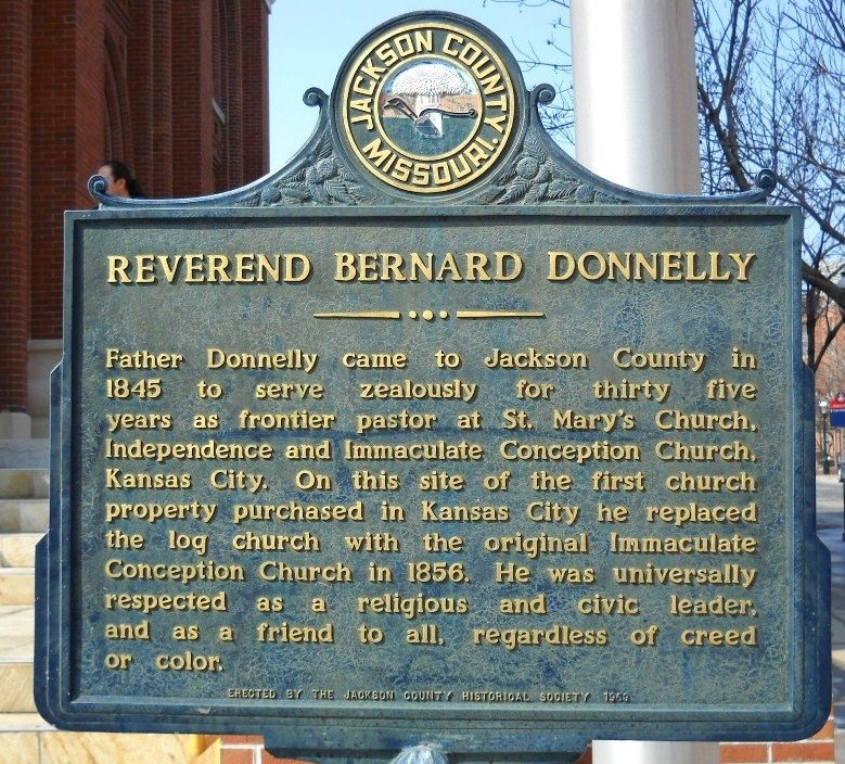 A historical marker stands outside the cathedral in honor of Donnelly. Image obtained from the Historical Markers Database.