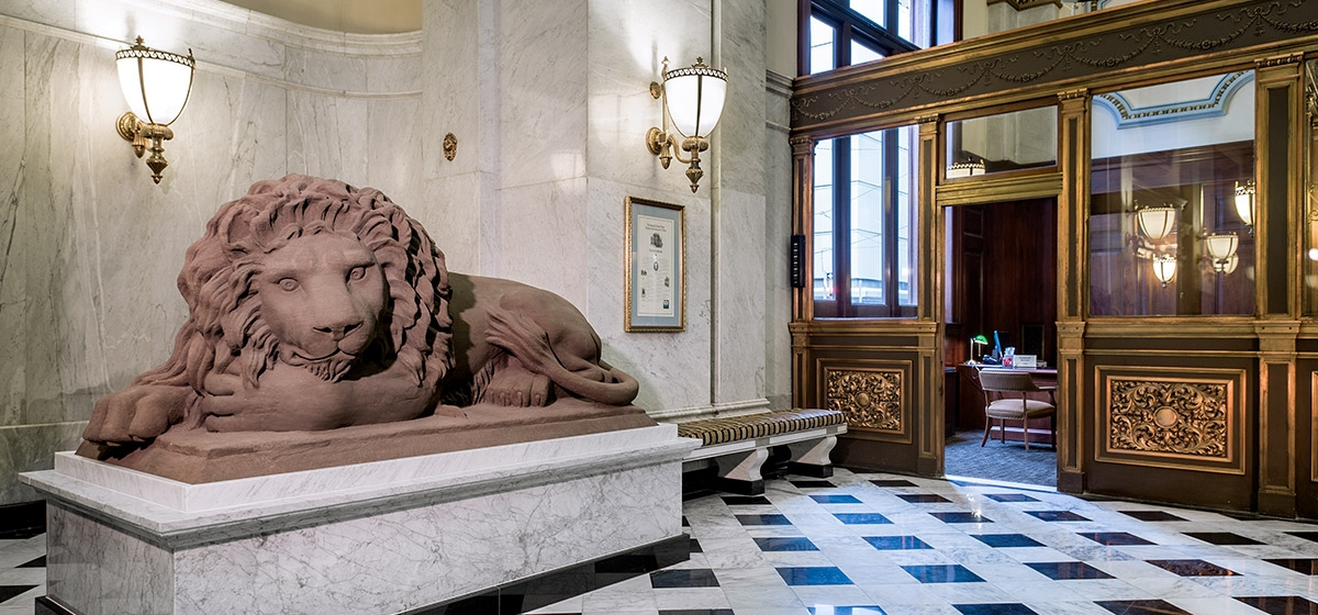 The recumbent lion now reposes inside the bank, safe from the deteriorating affects of the weather.