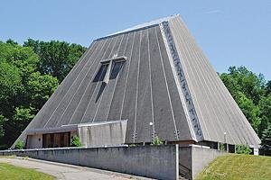 "Sacred Heart Church was known colloquially as ""the concrete tent"" and closed in 1997 due to spalling."