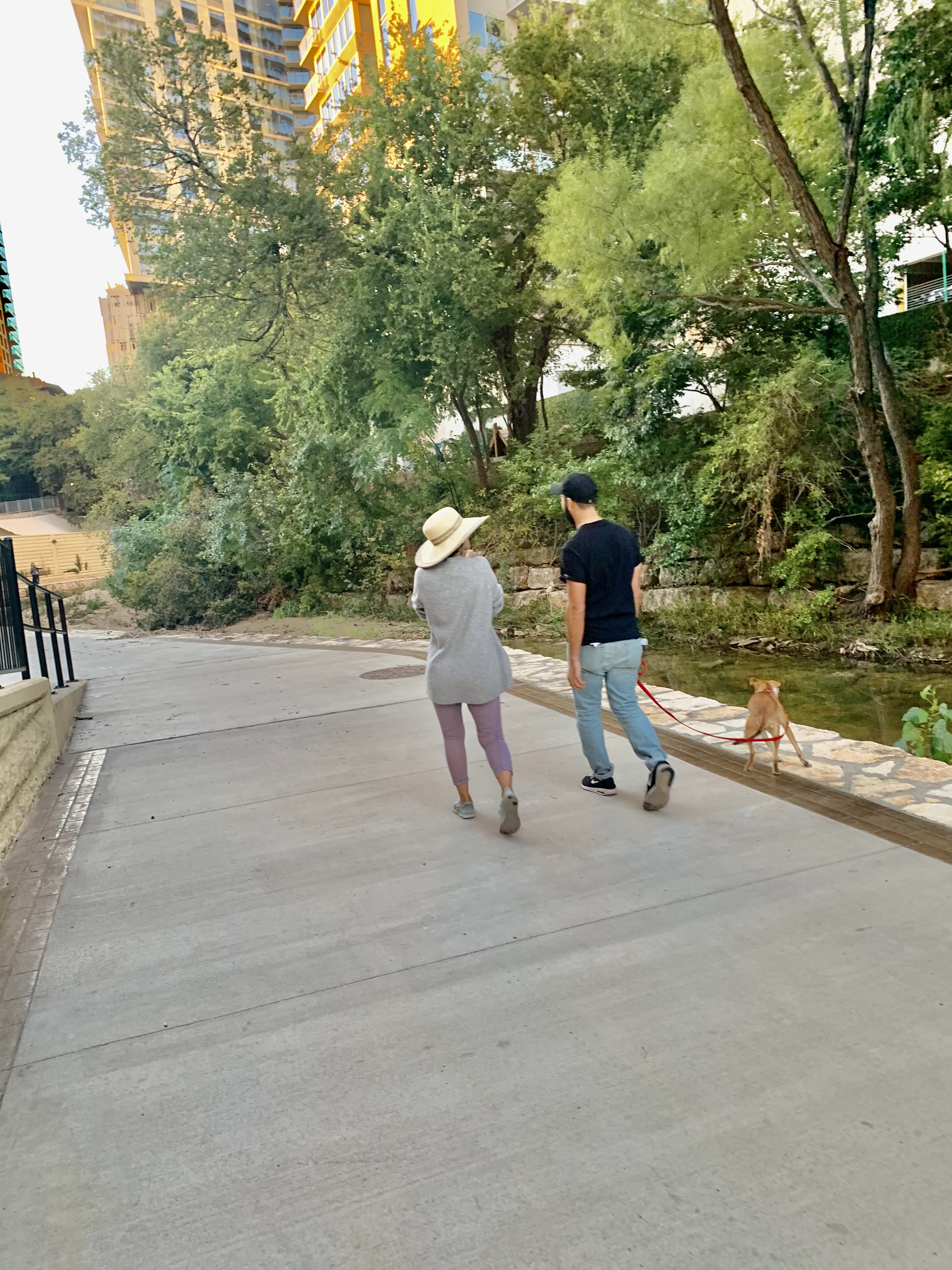 A couple walking along the paved trail with their pet. (September 2019)