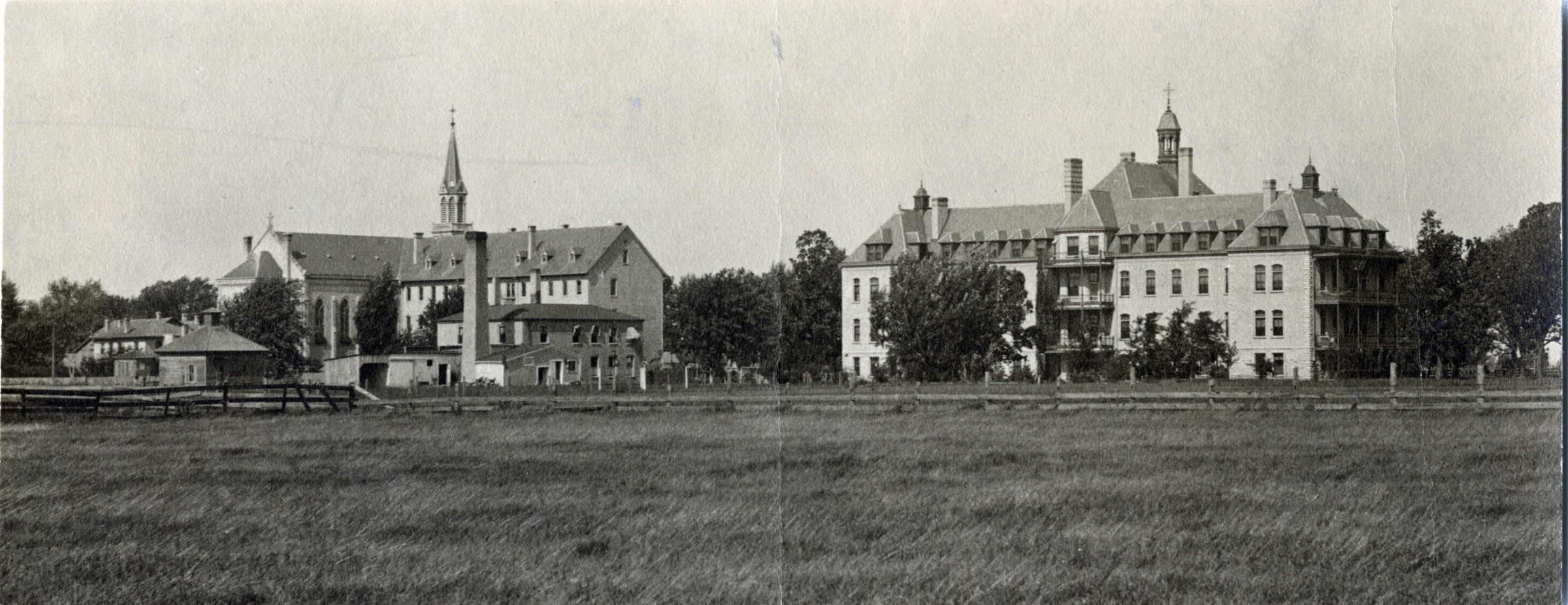 Panoramic view showing St. Agnes Hospital on the right, the convent in the center, and the two-story frame house that served as the original motherhouse on the far left.