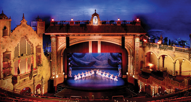 The Olympia was designed as an atmospheric theater, with the interior made to look like an outdoor amphitheatre in a Spanish garden. Image obained from Ocean Drive Magazine.