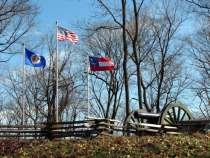 Shy's Hill features cannons and an American flag, a Confederate flag, and a Minnesota state flag which honors Union regiments who captured Shy's Hill.