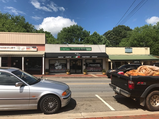 Strip of restaurants, Dot's Restaurant on the right.