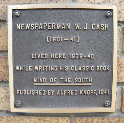 Plaque acknowledging the apartments as the former home of W. J. Cash. The plaque states that Cash lived in the apartments from 1939 to 1940, but Cash in fact moved into the apartment in 1938.