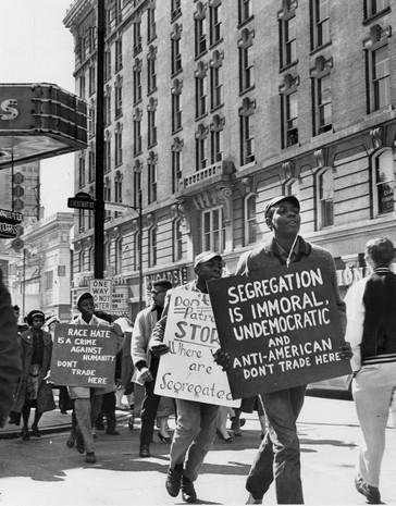 A 1961 protest against segregation near Kaufman-Straus Department store.