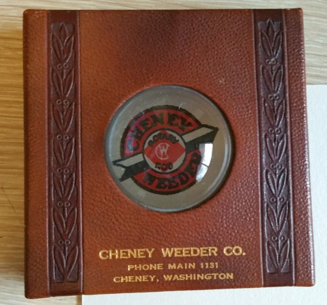 The Cheney Weeder logo appears under a desk magnifier.