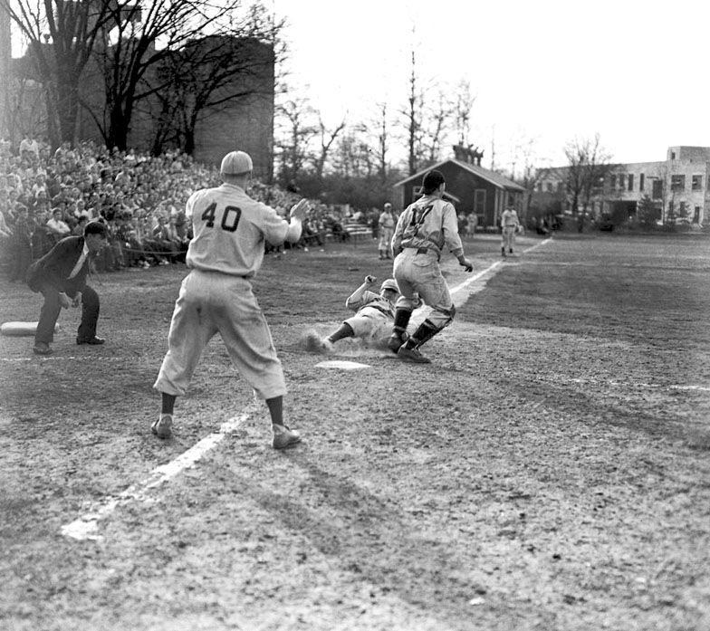 Pictured is a Spring Training game between the Cleveland Indians and the Cincinnati Reds in 1944. A large audience is visible on the left with some of the little seating that was available. As the field deteriorated, limited seating capacity became another driving reason for the closure of Jordan Field.