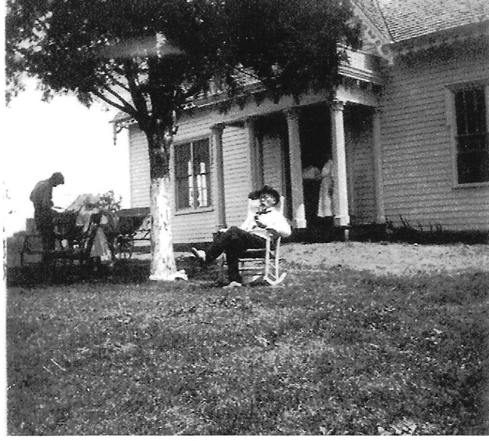 Judge Joseph Lowe sits in front of the home, circa 1913