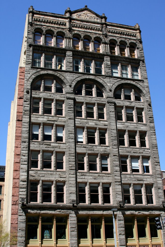 The Ewart Building was designed in the Richardson Romanesque style and was built in 1891.