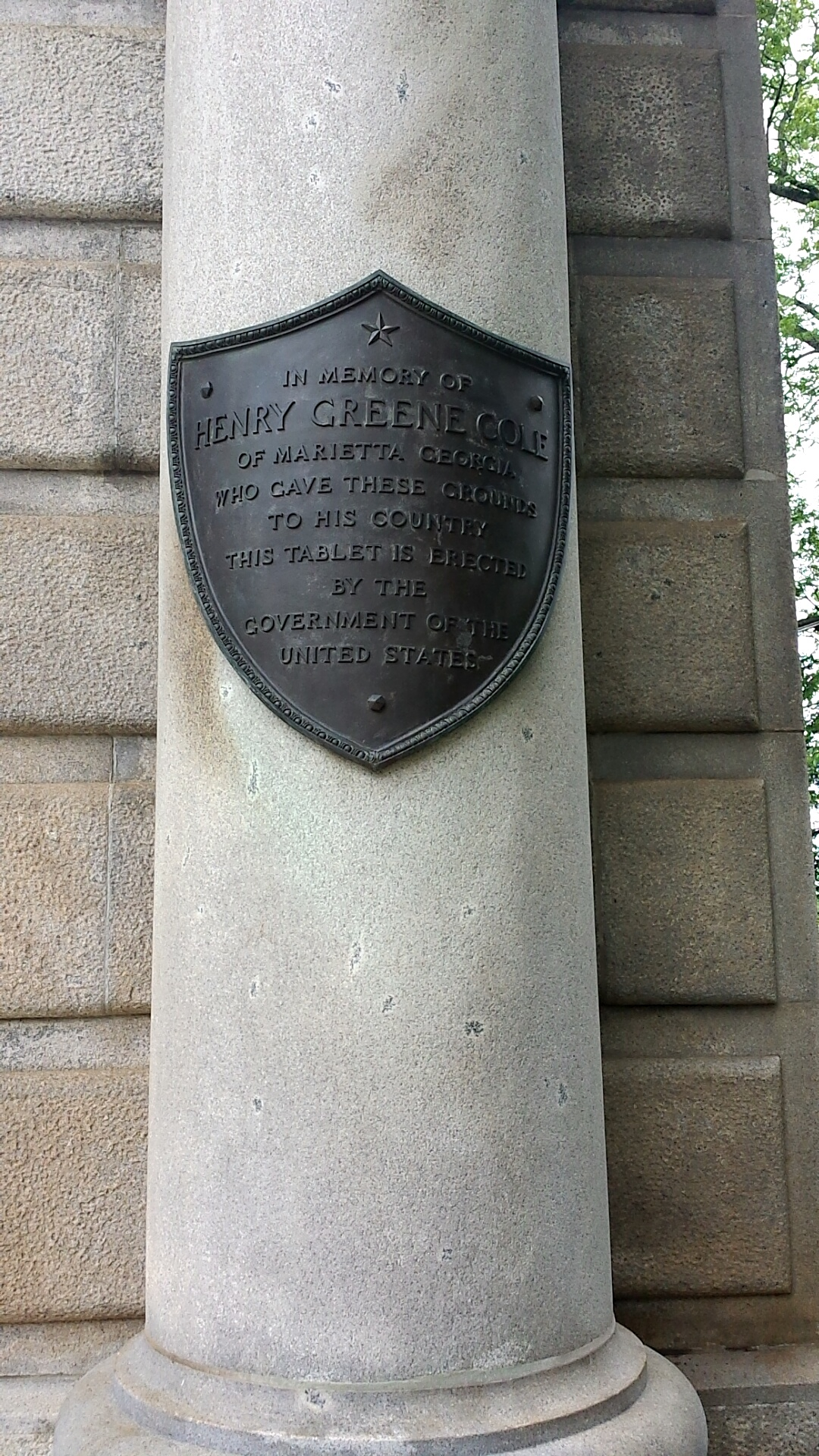 This plaque commemorates the memory of Henry Greene Cole, who donated the land for the cemetery.