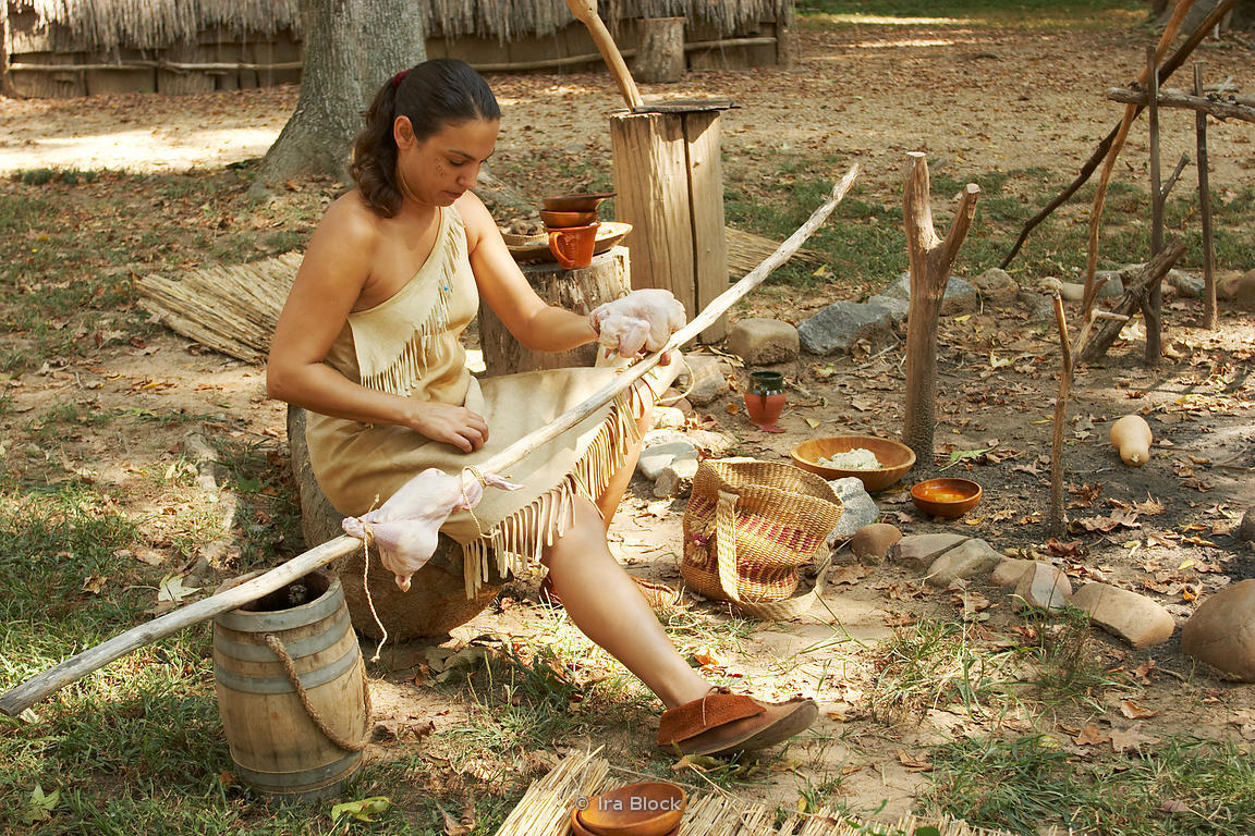 An interpretive guide representing the local Appomattoc tribe makes tools and other crafts found at the time.