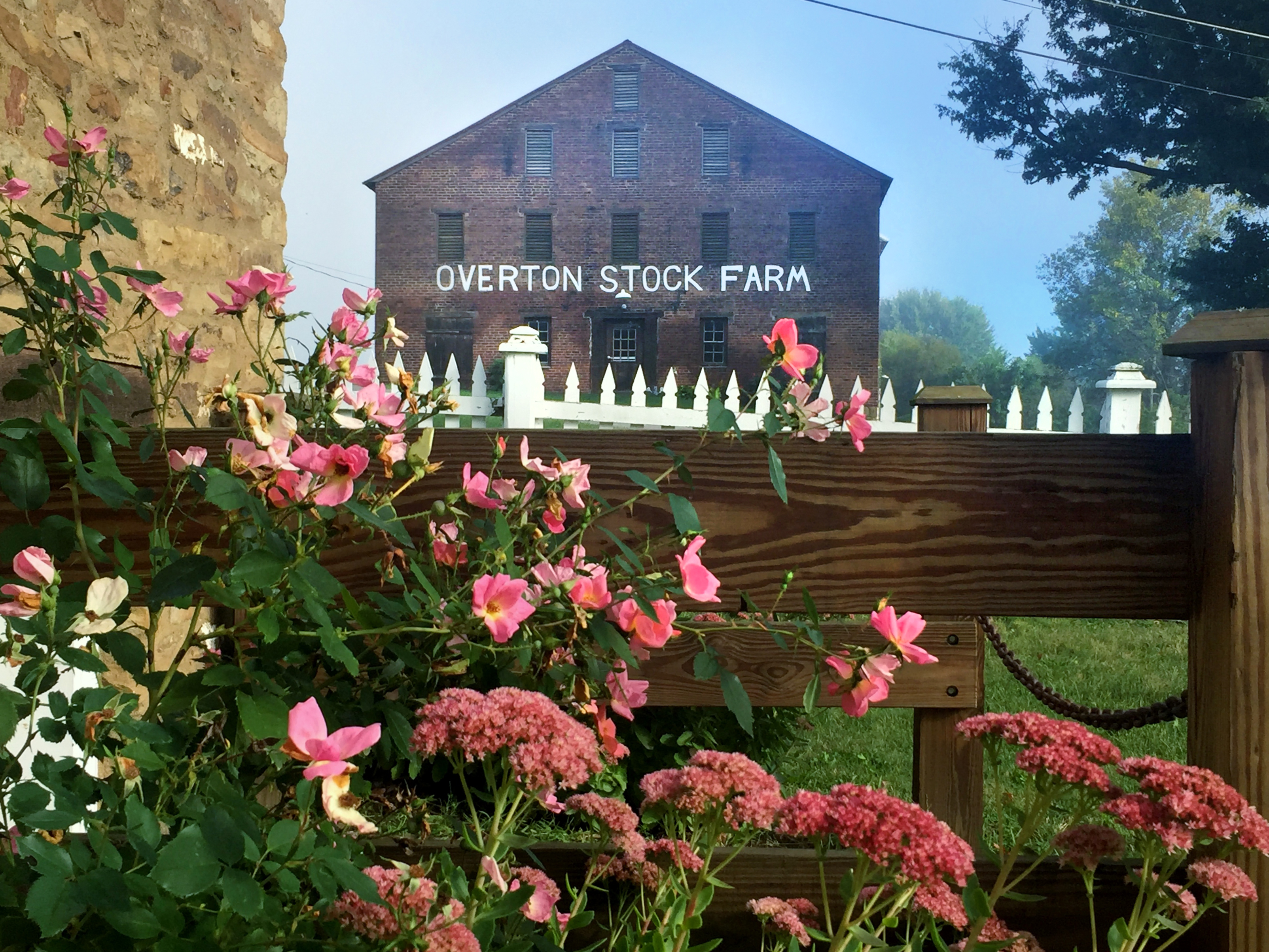 A brick barn and gardens at West Overton. Photo by West Overton Village.