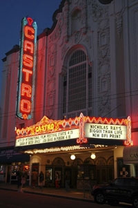 The Castro lit up at night time.