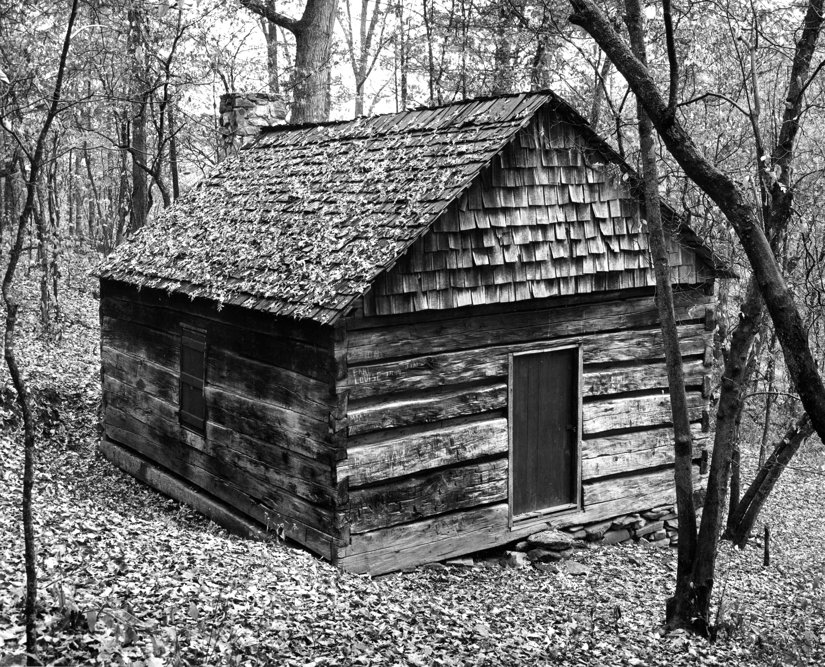 The Heritage Cabin in its original location prior to being moved to campus.