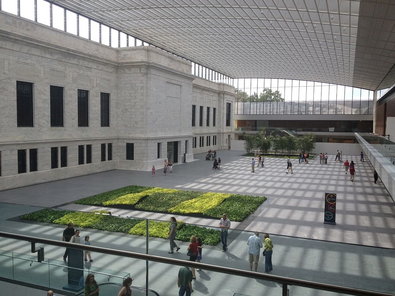 The atrium built in 2012 provides a shaded area over the space between the museum wings.