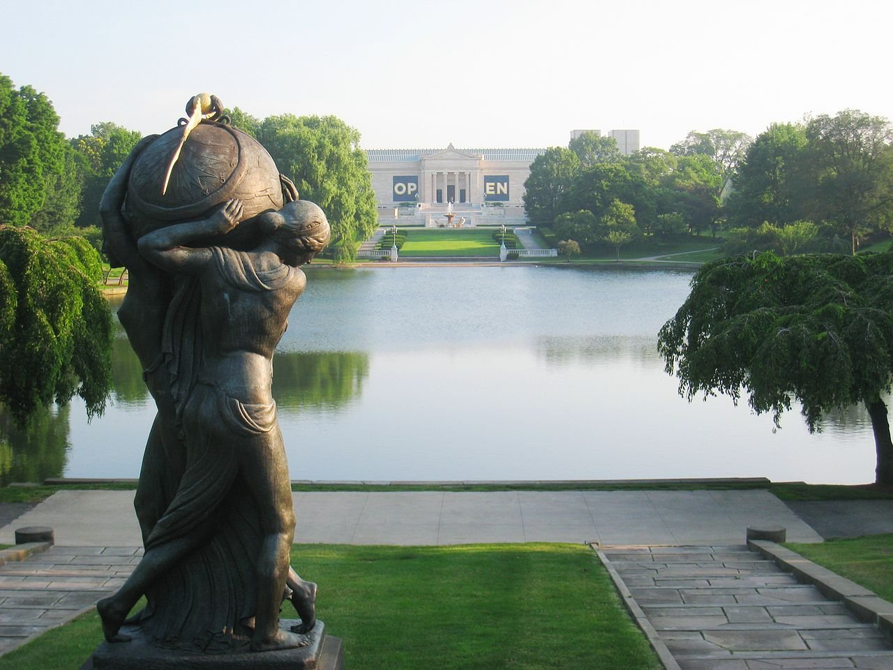 "This sculpture, ""Night Passing the Earth to Day"" by Frank Jirouch, which is part of the museum's collection, overlooks the Wade Lagoon towards the museum. Other sculptures are located on the museum grounds as well."