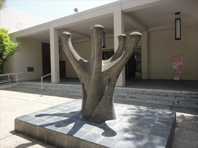 This large menorah sculpture stands in front of Temple Emanu El. Photo: Metro2, via Waymarking.com