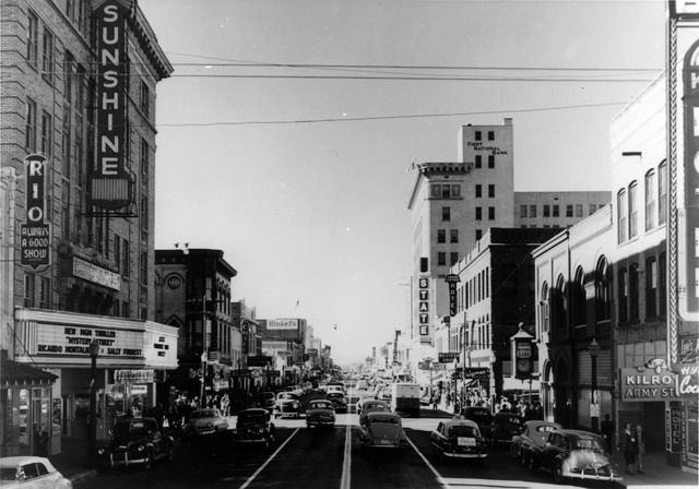 Looking down Central Ave. SW, circa 1940s-1950s. Sunshine Building seen on the left, especially the neon sign. Courtesy of the New Mexico Jewish Historical Society.