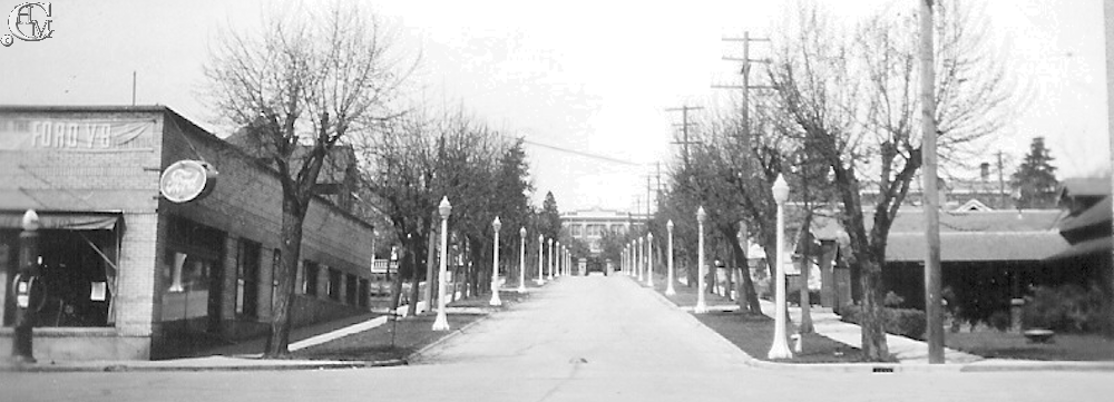 The view up Normal Ave in 1935 shows C.A. Ratcliffe & Son on the left side of the street. On the right is the Jerue Funeral Home.