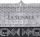 J.A. SKinner's named etched into top of building.