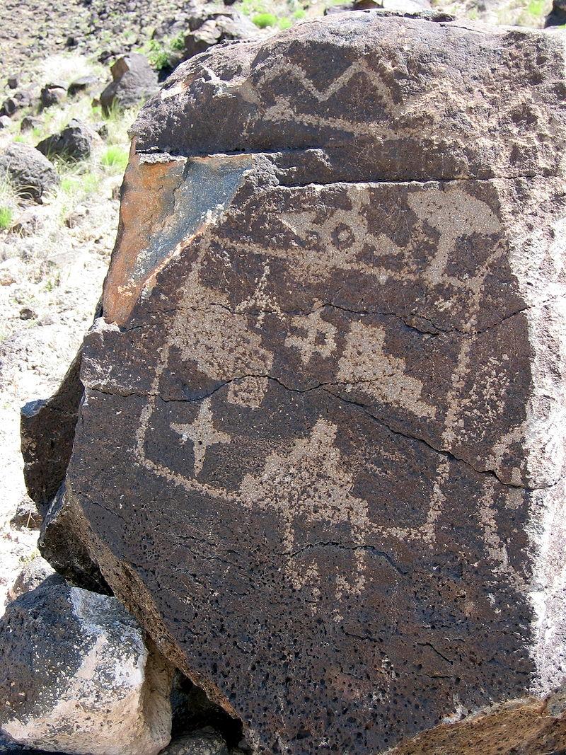 Petroglyphs on a large rock at Petroglyph National Monument