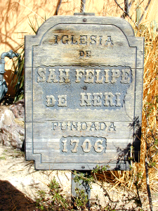 Sign near church where first church building for the city was located and when it was constructed.