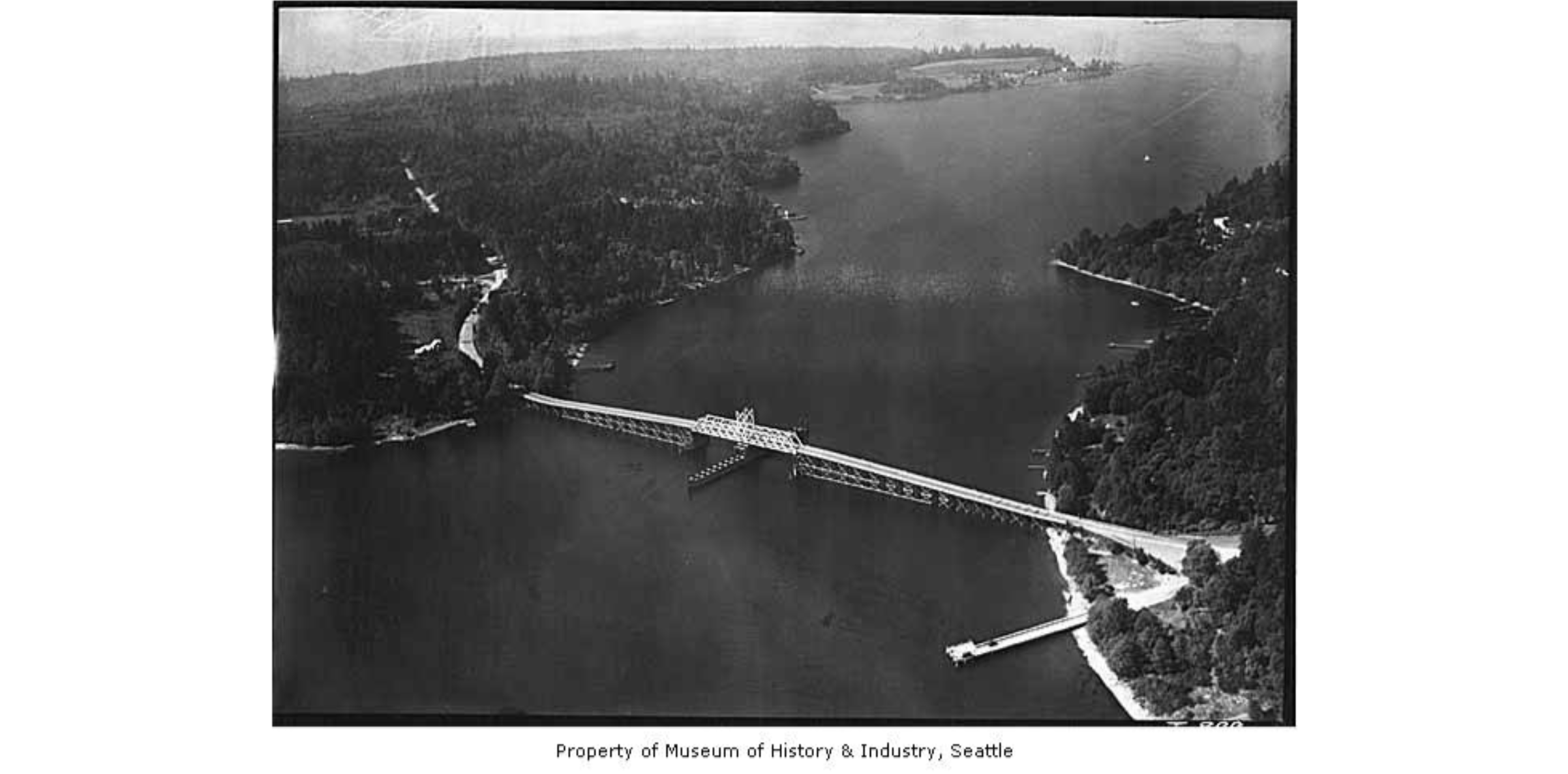 Photo of East Channel Bridge in 1938 by Charles Laidlaw, courtesy of MOHAI. This was the first bridge to connect the Seattle area to Mercer Island.