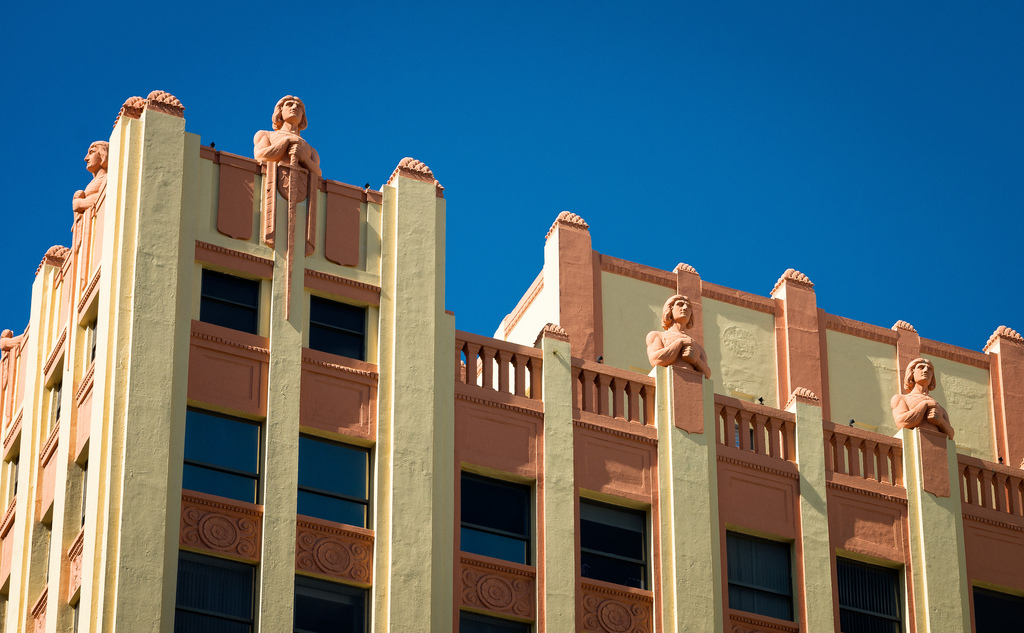 The building is known for its eleven knight-like figures decorating the parapet. Image obtained from Flickr.