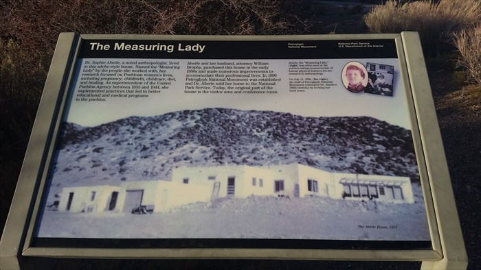 """The Measuring Lady"" sign at the Petroglyph National Monument"