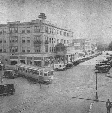 View of the Hotel Huntington with a trolley turning the corner