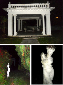 Sculptures and the building's patio at night.