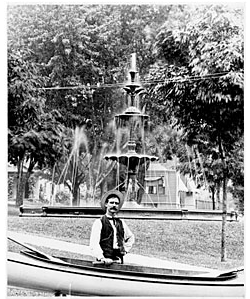 Photo of George King, a Janesville Druggist, in the Lower Courthouse Park. Circa early 1900s.