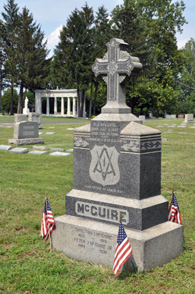 Peter J. McGuire gravesite with Memorial in background