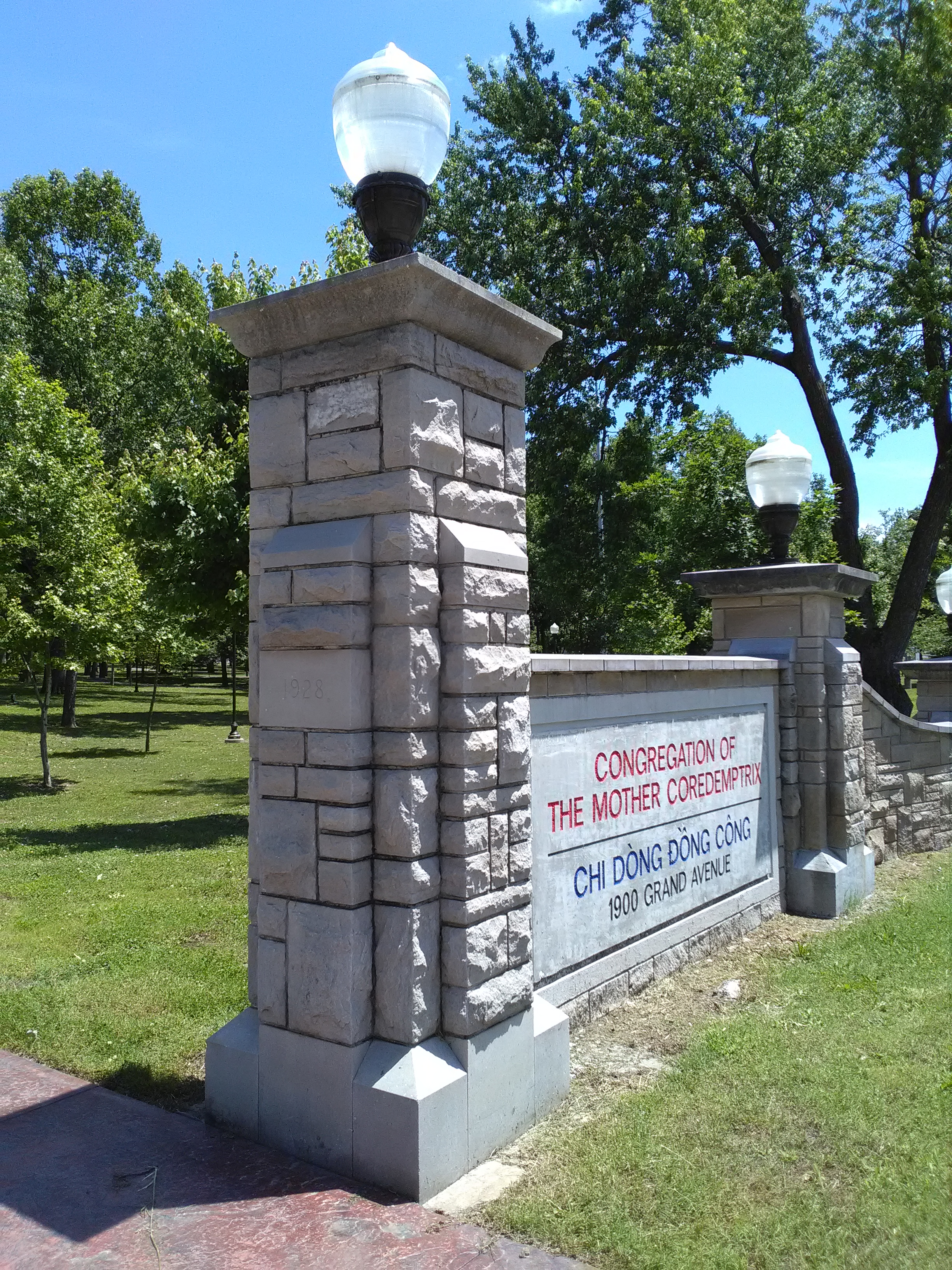 One of 2 entrance columns in front of building donated by Q P Club, a booster group, affiliated with Ozark Wesleyan College. Marian Louisa Powers Winchester, Powers Museum benefactor, was a member of this club when she attended the college.