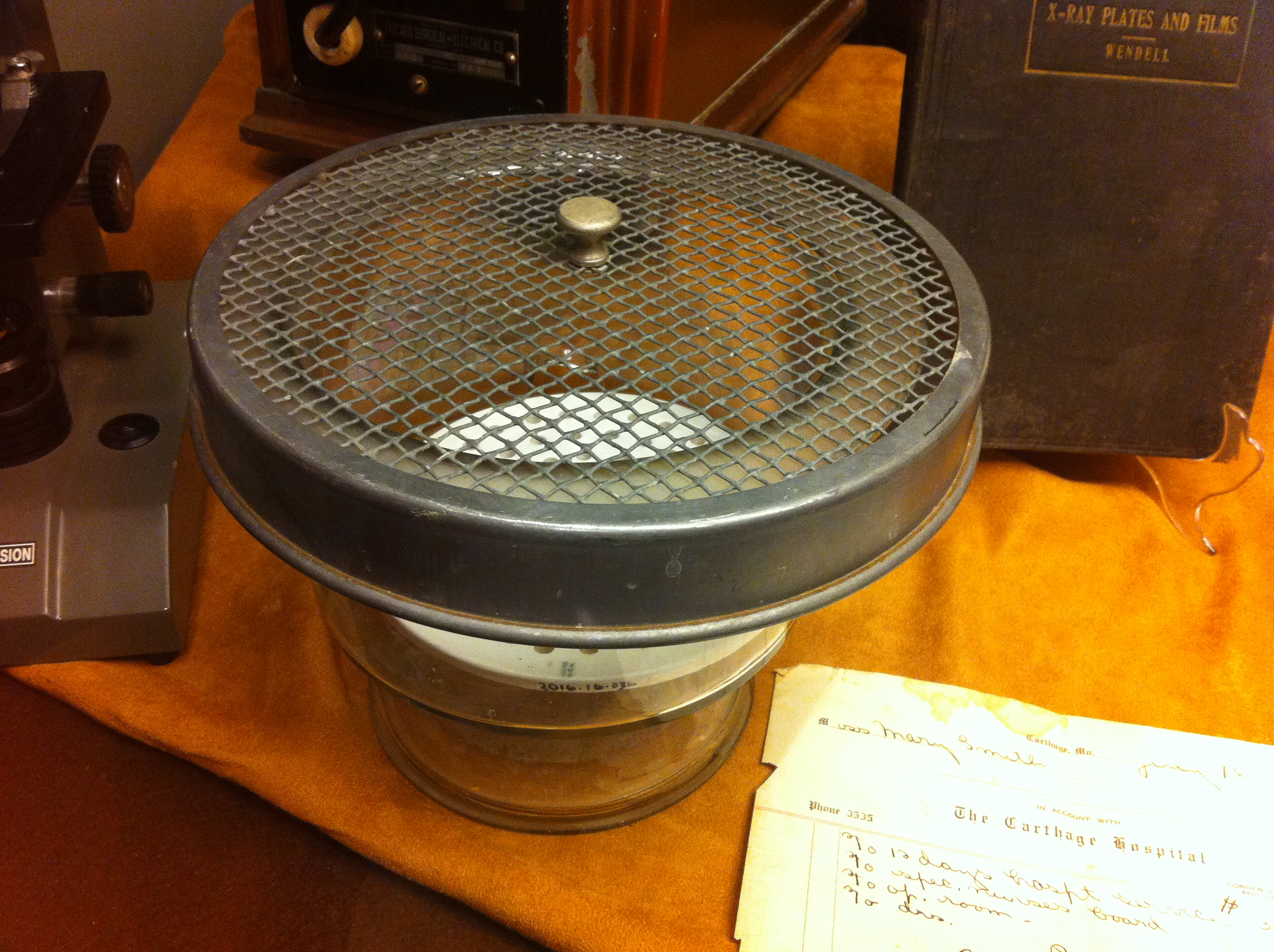 Close-up of one of the diagnostic items in 2017 display. The glass container with wire lid was used to house African frogs used in pregnancy testing.